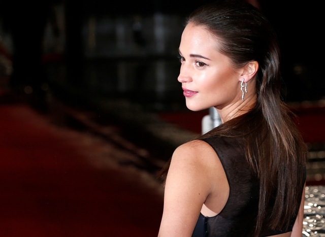 Alicia Vikander poses as she arrives for the British Academy of Film and Arts (BAFTA) awards ceremony at the Royal Opera House in London February 10, 2013. REUTERS/Suzanne Plunkett (BRITAIN - Tags: ENTERTAINMENT) (BAFTA-ARRIVALS) - RTR3DL3Y